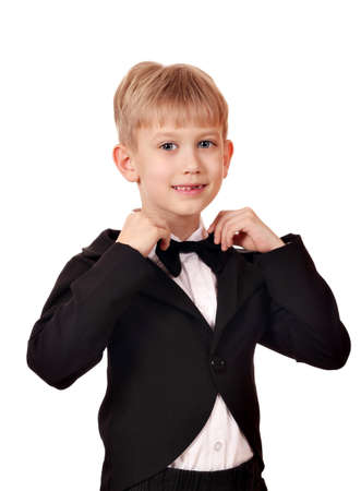 boy with bow tie and black tuxedo suit photo