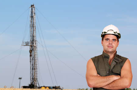 oil worker and oil rig photo