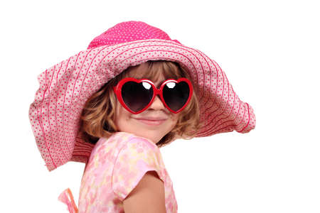 little girl with hat and sunglasses portrait photo