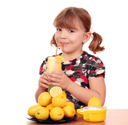 little girl drink lemonade photo