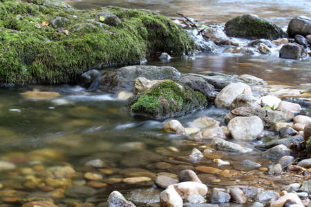river stones: mountain creek spring nature scene Stock Photo