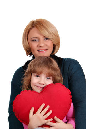 happy mother and daughter with heart family scene photo