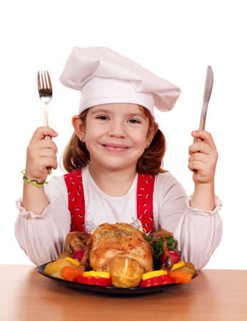 little girl cook with grilled chicken Stock Photo