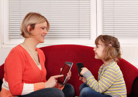mother and daughter with tablet and smart phone Stock Photo - 17341311