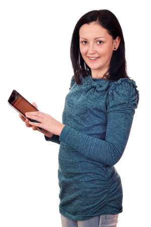 beautiful teenage girl with tablet pc on white Stock Photo - 17415247