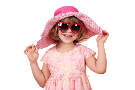 happy little girl with big hat and sunglasses on white photo