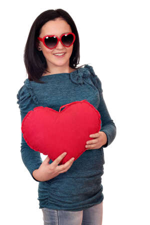 happy teenage girl with red heart on white  photo