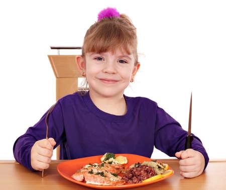 happy little girl healthy eating photo