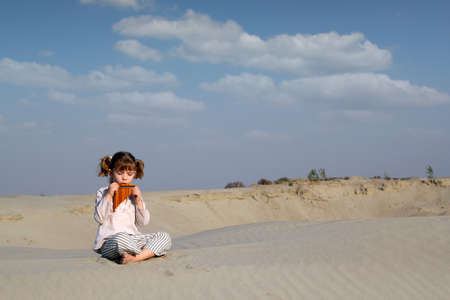 panpipe: little girl play music on pan pipe Stock Photo