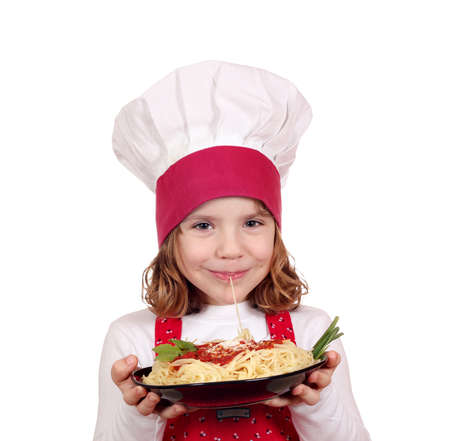 little girl cook eat spaghetti photo