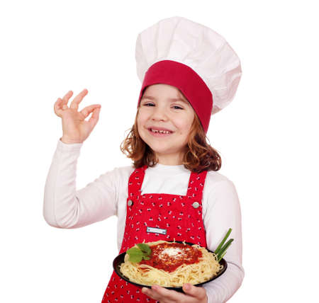 pasta dish: happy little girl cook with spaghetti Stock Photo