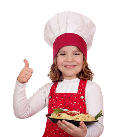 happy little girl cook with spaghetti and thumb up photo