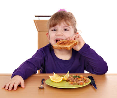 little girl eat toast bread and tuna fish for breakfast photo