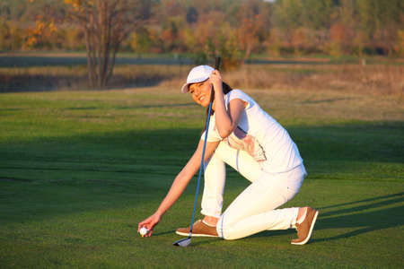 beautiful girl golf player on field Stock Photo - 18091903