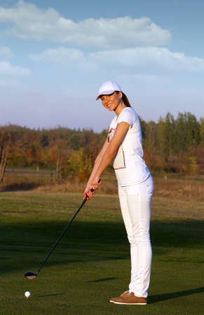 active lifestyle: happy girl golf player ready for shot