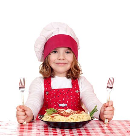 beautiful little girl cook with spaghetti for lunch photo