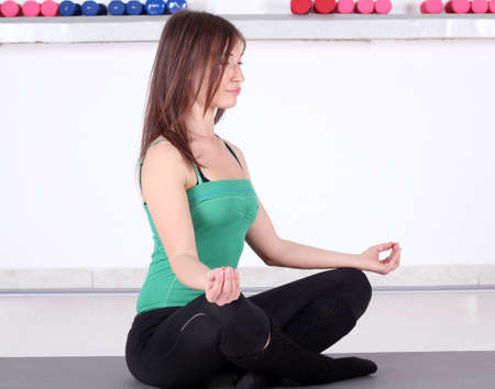girl meditates and prepares for fitness exercise  photo