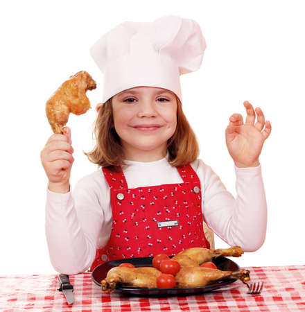 drumsticks: little girl cook with chicken drumstick Stock Photo