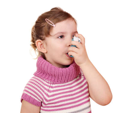 asthma: little girl with asthma inhaler Stock Photo