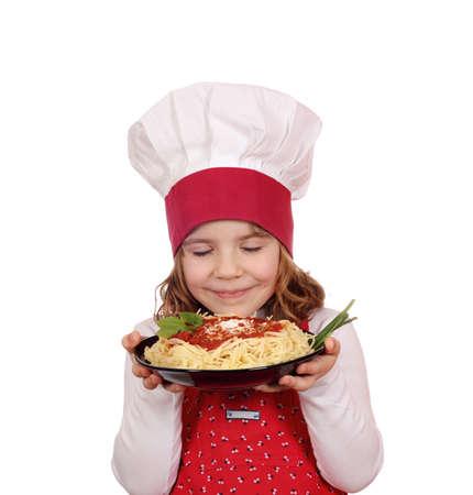 little girl cook enjoys spaghetti