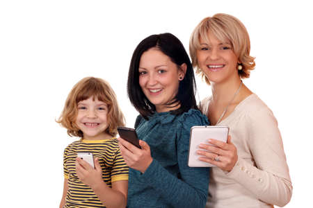 three generation little girl teenage girl and woman with tablet and smart phones photo