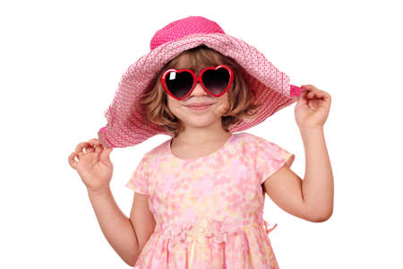 beautiful little girl with sunglasses and big hat photo