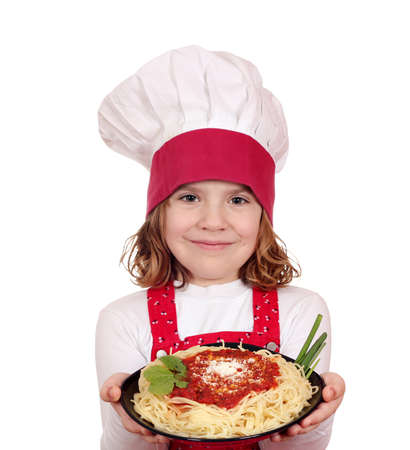 beautiful little girl cook hold dish with spaghetti photo