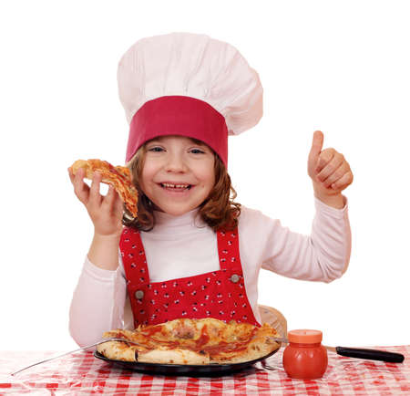 happy little girl cook eat pizza photo