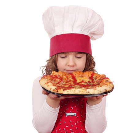 little girl cook smells pizza photo