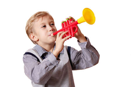 boy play trumpet on white  photo
