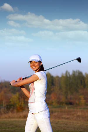 beautiful girl golf player on field photo