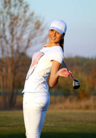 beautiful girl golf player posing photo