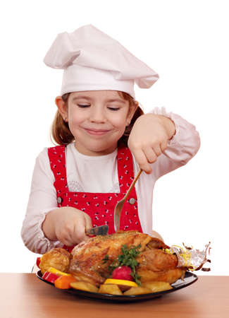 little girl cook eat roasted chicken