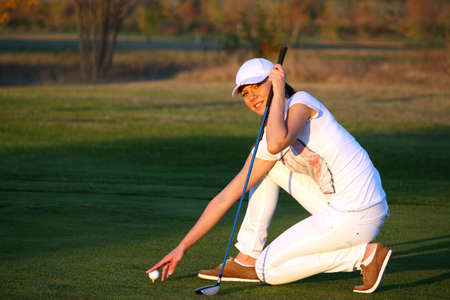 girl golf player preparing for shot Stock Photo - 19029438