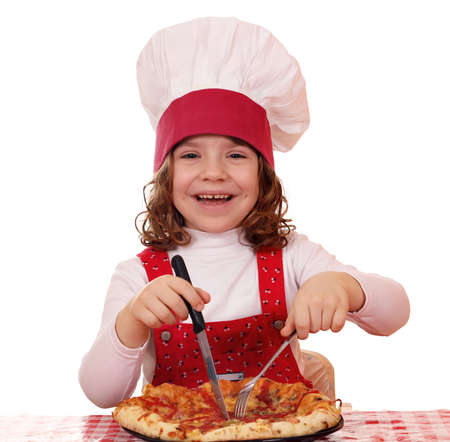poco feliz cocinero ni�a come la pizza photo