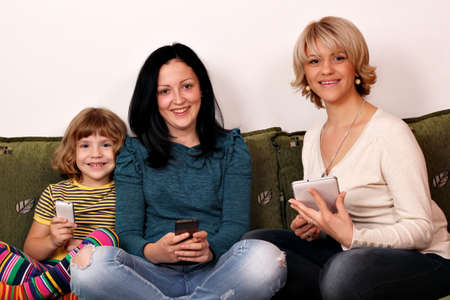little girl teenage girl and woman play with smart phones and tablet Stock Photo - 19061664