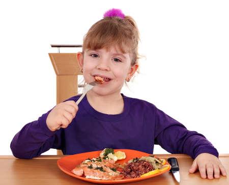 niños comiendo: niña alimentación saludable lindo Foto de archivo
