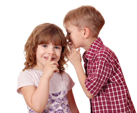 boy whispering a secret little girl  photo