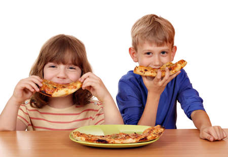 happy little girl and boy eat pizza Stock Photo
