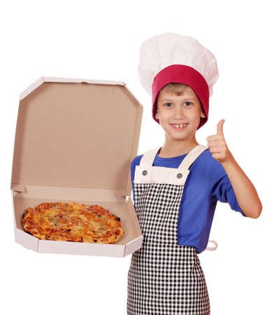 happy boy chef hold box with pizza photo