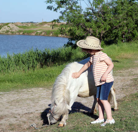 child cowboy and pony horse  photo