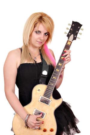 beautiful teenage girl with electric guitar photo