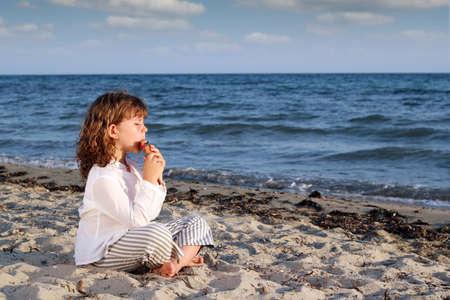 panpipe: little girl play pan pipe on beach