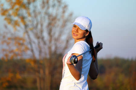 girl golf player outdoor portrait photo