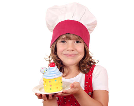 little girl cook with sweet cake photo