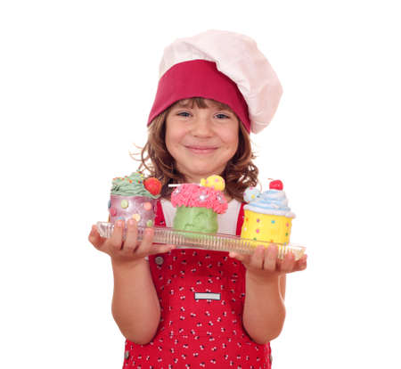 happy little girl cook with colorful sweet cupcakes photo