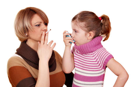 woman with cigarette and little girl with asthma inhaler Standard-Bild