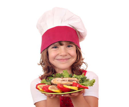 beautiful little girl cook with salmon seafood photo