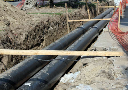 polyurethane: construction site with community heating system pipes