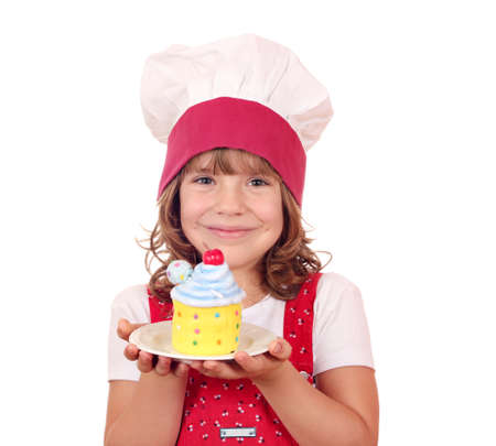 little girl cook with colorful cupcake portrait photo
